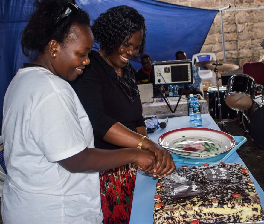 GBC MD Rose Maghas and Pistis Founder Gladys Wekesa cutting cake